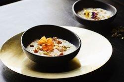 Saffron sago pearl pudding, jaggery praline and mixed nuts