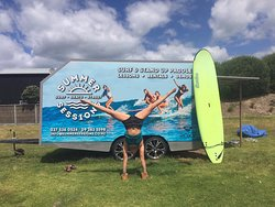 Summer Sessions Trailer at Omaha Beach (next to surf club). Rent surf boards, body boards, and wetties. Also the meeting point for surf lessons.