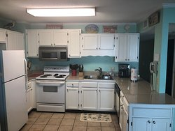 Fully equipped kitchen with dishwasher, trash disposal and a Keurig coffee maker.