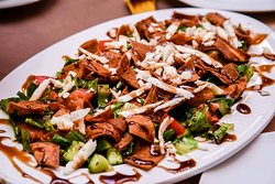 Very delicious Fattoush salad dressed with pomegranate sauce.