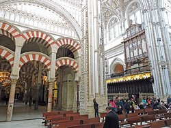 The red-and-white double arches of the Mezquita's prayer hall next to the choir of the Catholic church built INSIDE the mosque. (AlpinerHut)
