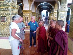 Young Monks are taking their English Speaking with tourists at the top of Mandalay Hill.