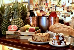 Breakfast is served. Fruits, cakes, toast and jam. Oh my!