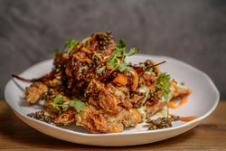 Spicy Soft Shell Crab served tempura style with a playful sriracha mayo sauce and fried red chills.