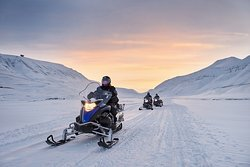 Explore the island on snow mobile