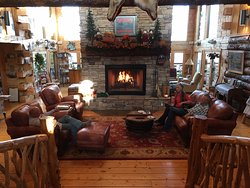 Guests enjoying visiting in front of the fireplace at White River Lodge.