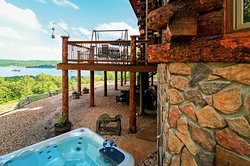 Hot tub, Flagstone patio, and deck area overlooking lake at White River Lodge.