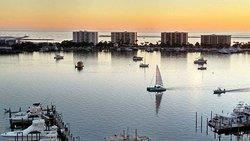 Sailing the Destin harbor at sunset