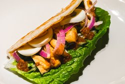 VEGGIE ROLL Paratha, boiled egg, lettuce, toufu, onion with satey sauce