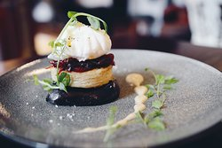 Bury black pudding on a potato scone with a red onion jam, dijon mustard topped with a poached egg