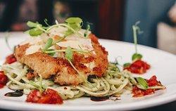 Chicken parmigiana with pesto linguine