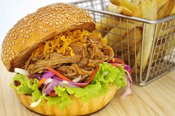 Pulled Pork - Low and slow barbecued pork shoulder, tangy coleslaw, topped with sweet potato crunchies between a toasted brioche bun