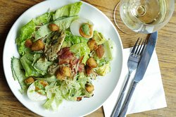 Chicken & Bacon Keto Salad - Marinated pan fried chicken breast, lettuce, celtuce, cucumber, and avocado dressed in homemade herb mayonnaise. Served with a soft boiled egg, keto croutons and parmesan