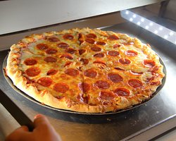 Thin crust (made daily), pepperoni, purchase whole pizza or by the slice.