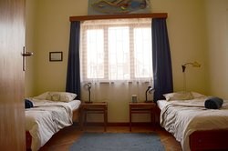 Twin Room B. This room has 2 single beds and a shared bathroom. A very cozy room to choose.
