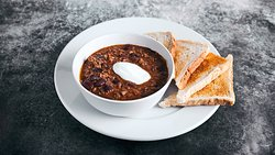 CHILI CON CARNE 300g House recipe made from a selection of imported Mexican chilies (Ancho, Guajillo and Arbol). Served with toasted bread.