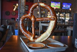 Famous fresh baked German pretzel served with house mustard and beer cheese.