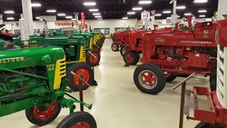 One of many aisles of tractors on display