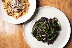 Fresh handmade pasta and squid ink risotto