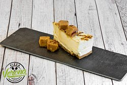 No matter how stuffed you are after the main course you always have room for a little dessert. 😋 Have a look at our Golden Vanilla Fudge Cheesecake. 🍰 It's a digestive biscuit base topped with a layer of light, creamy cold set cheesecake. The cheesecake is finished with a vanilla fudge cubes, a feathering of rich caramel sauce and a sprinkling gold colored sugar crunch. It looks divine! 😍🍰