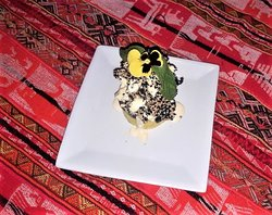 Causita (pollo con piure de papas con semillas de sesamo) Causita ( fired chicken with pure de potatoes acompanied by sesame seeds)