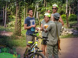 Take a relax after 2 hours cycling. Drink fresh king coconut  for make you refresh .