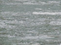 Ice covered river sounds like thunder as it freighter cut thought the ice.