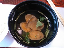 A day-trip set meal provides a bowl of rice and clear soup with littleneck clams toward the end of it.