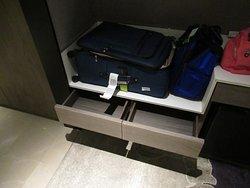 Storage drawer under luggage shelf.