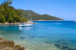 Sailboat anchored in a cove - island Mljet