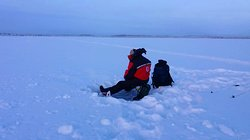 Ice-fishing in the middle of nowhere. Perfect to relax.
