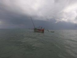 great old wooden fishing boat and stormy sky!!!