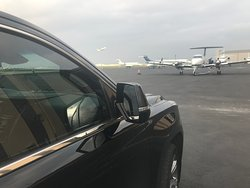 Private Chauffeur waiting at MillionAir Aviation.