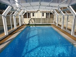 Swimming Pool with hot water and a Telescopic Cover Pool.