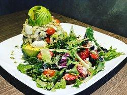 Aguacate Relleno de Serenata de Bacalao/House Salad
