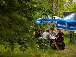 We have tables in the garden, where you can just relax or enjoy one of our daily buffets, cake or ice cream.
