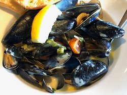 Mussels in a delicious creamy sauce with tomatoes