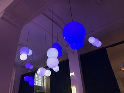 Kinetic light installation in dining room and bar area