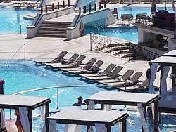10 poolside chairs reserved with towels all day and never used.