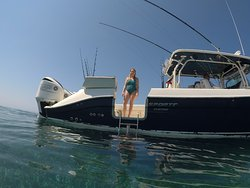Easy access door with ladder for snorkeling on Roatan Island Charters 42' center console.