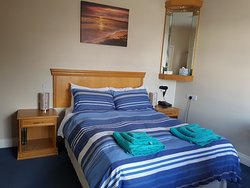 Room n 4  has:  1 double bed, a wardrobe, a desk, a bathroom,  a telephone  ,          a kettle, an iron, an iron board, a hair dryer and a TV.