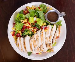 Ava's Grilled Chicken Salad grilled chicken, sweet corn, roasted red pepper, & red onion served warm over romaine lettuce with cranberry chipotle ranch dressing