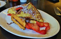 Nutella Stuffed French Toast thick slices of french toast sandwiched together and stuffed with Nutella and banana topped with fresh strawberries
