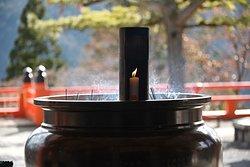 Incense and candles burning at Kuramadera temple