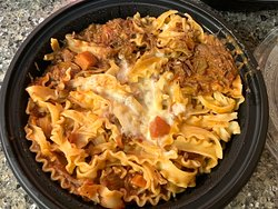 Carryout: Braised Beef Bolognese with Pappardelle - Meat sauce (includes pan-seared beef and Italian sausage) with ruffled pappardelle pasta and alfredo.