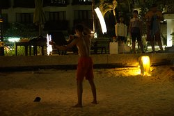 The hotel staff performs in the evening in the beach area