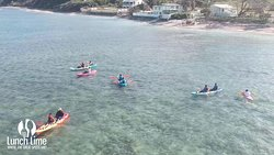 Kayaking in the clear waters of Bath Bay