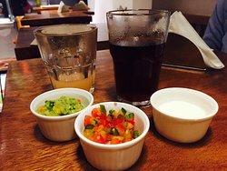 Burrito bowl, enchiladas, drinks and dips