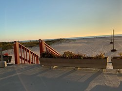 Deck facing beach and Gulf of Mexico. Sand volleyball net on beach.