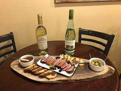 Smoke Duck appetizer with a crisp bottle of Vinho Verde from Portugal or Santa Margherita from Italy.
